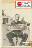 Unknown Man hold Associated Sign
